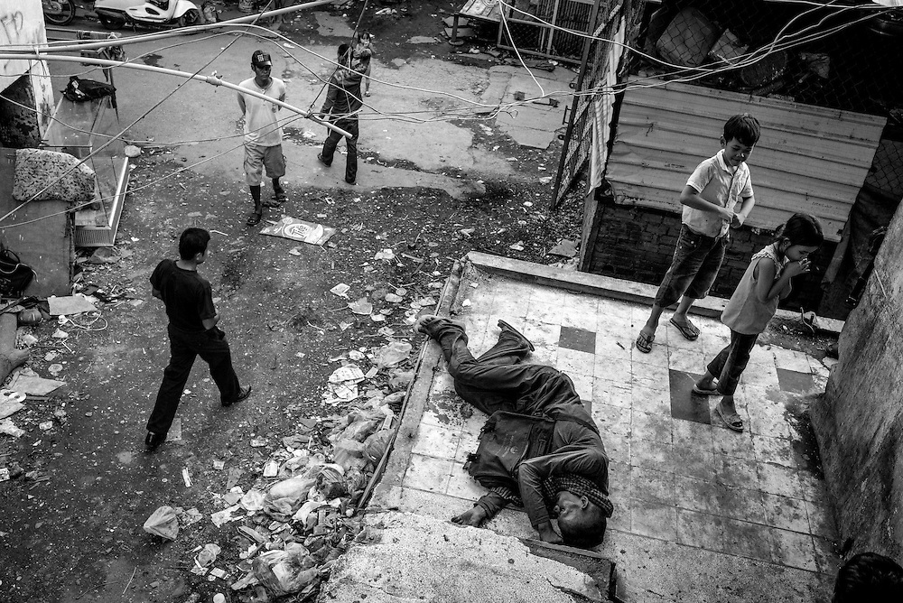 Alcoholism is one of the side effects of low employment opportunities for Borei Keila residents. The community of Borei Keila in Phnom Penh was once home to hundreds of families before land developer Phanimex bought the property rights to the area and forcefully evicted the residents who refused to accept their compensation package. Those who remained were forced to squat in the remains of the buildings, living in slum-like conditions and without access to plumbing or public electiricity.