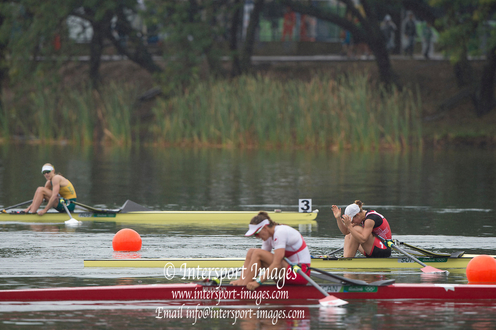 Rio de Janeiro. BRAZIL right SUI W1X. Jeannine<br /> GMELIN, <br />   2016 Olympic Rowing Regatta. Lagoa Stadium,<br /> Copacabana,  &ldquo;Olympic Summer Games&rdquo;<br /> Rodrigo de Freitas Lagoon, Lagoa. Local Time 10:18:01  Friday  12/08/2016<br /> [Mandatory Credit; Peter SPURRIER/Intersport Images]