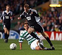 Fotball: UEFA Champions League 2001/2002. Celtic v Rosenborg, Champions League, Celtic park, Glasgow.<br /> Harald brattbakk rushes past Stilian Petrov