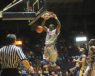 "Ole MIss forward Reginald Buckner (2)  dunks at the C.M. ""Tad"" Smith Coliseum in Oxford, Miss. on Wednesday, November 17, 2010."