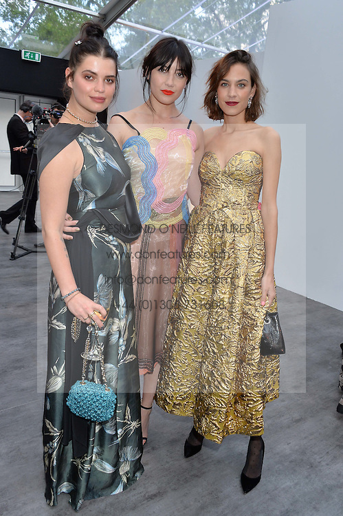Left to right, PIXIE GELDOF, DAISY LOWE and ALEXA CHUNG at British Vogue's Centenary Gala Dinner in Kensington Gardens, London on 23rd May 2016.