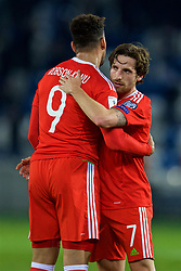 TBILSI, GEORGIA - Friday, October 6, 2017: Wales' Joe Allen and Hal Robson-Kanu embrace after beating Georgia 1-0 during the 2018 FIFA World Cup Qualifying Group D match between Georgia and Wales at the Boris Paichadze Dinamo Arena. (Pic by David Rawcliffe/Propaganda)