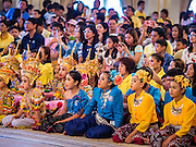 10 JANUARY 2015 - BANGKOK, THAILAND: Thai children wait to participate in a cultural performance at Government House for Children's Day. National Children's Day falls on the second Saturday of the year. Thai government agencies sponsor child friendly events and the military usually opens army bases to children, who come to play on tanks and artillery pieces. This year Thai Prime Minister General Prayuth Chan-ocha, hosted several events at Government House, the Prime Minister's office.    PHOTO BY JACK KURTZ