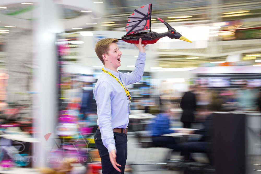 UNITED KINGDOM, London: 25 January 2016 Jack Arrowsmith flies a animatronic Terrordactyl through The Toy Fair at Olympia, the UK'S only dedicated game and hobby event with more than 260 toy and gaming brands. The fair runs until tomorrow. Rick Findler / Story Picture Agency