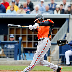 Mar 2, 2013; Port Charlotte, FL, USA; Baltimore Orioles third baseman Manny Machado (13) hits a triple during the top of the sixth inning of a spring training game against the Tampa Bay Rays at Charlotte Sports Park. Mandatory Credit: Derick E. Hingle-USA TODAY Sports
