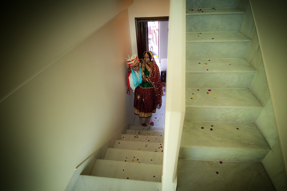 Husband carries his newly wed wife to their decorated room (Varanasi, India).