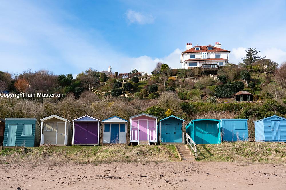 Wooden beach huts at Coldingham Bay in Scottish Borders, Scotland, United Kingdom