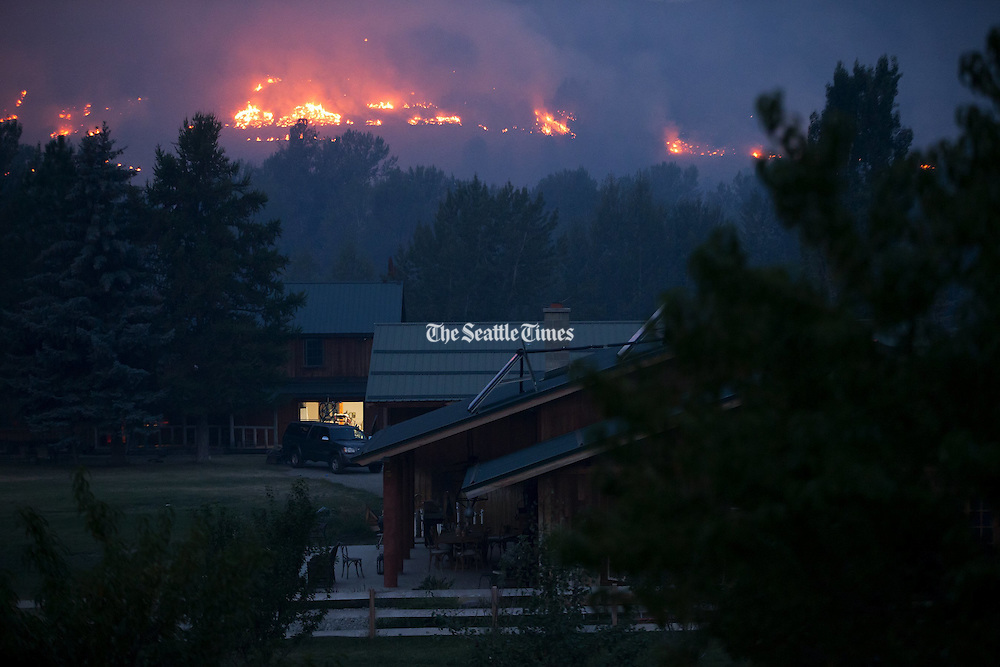 Fires burn on the hillsides above Twisp, Wash. Thursday, Aug. 20, 2015.<br />