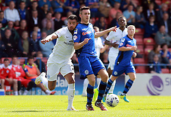 Peterborough United's Kyle Vassell in action with Rochdale's Joe Rafferty - Photo mandatory by-line: Joe Dent/JMP - Mobile: 07966 386802 09/08/2014 - SPORT - FOOTBALL - Rochdale - Spotland Stadium - Rochdale AFC v Peterborough United - Sky Bet League One - First game of the season