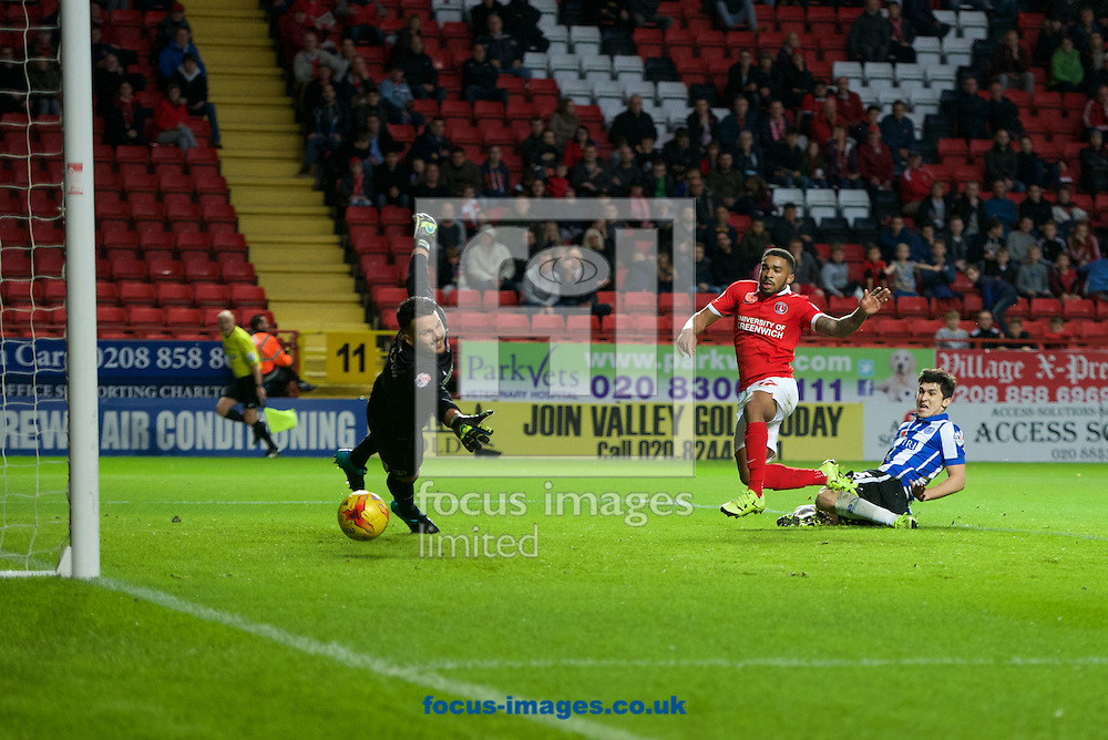 Fernando Forestieri of Sheffield Wednesday gets past Tareiq Holmes-Dennis of Charlton Athletic to score and make it 3-1 during the Sky Bet Championship match at The Valley, London<br /> Picture by Alan Stanford/Focus Images Ltd +44 7915 056117<br /> 07/11/2015