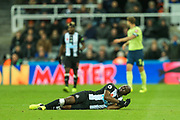 Jetro Willems (#15) of Newcastle United lies on the floor looking for treatment as the game continues during the Premier League match between Newcastle United and Bournemouth at St. James's Park, Newcastle, England on 9 November 2019.