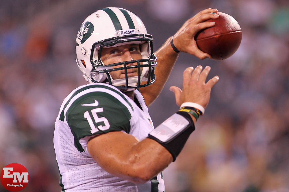 Aug 26, 2012; East Rutherford, NJ, USA; New York Jets quarterback Tim Tebow (15) throws a pass during warmups for their game against the Carolina Panthers at MetLife Stadium.