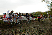Rainbow on the berg: 2009 World Cyclocross champ Neils Albert climbs the famous Koppenberg during the GVA Koppenberg Cross, Oudenaarde, Belgium.