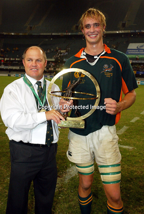 South African Coach Eugene Eloff and captain Alistair Hargreaves with trophy after the Under 19 Rugby World Cup final between New Zealand and South Africa at the ABS Stadium, Durban, South Africa, 17 April, 2005. South Africa won the match 20-15. PHOTO: Africa Visuals/PHOTOSPORT