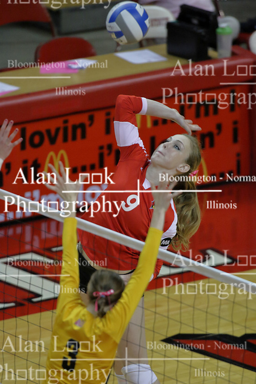 23 October 2010: Katie Culbertson attacks the direction of Elizabeth Field during an NCAA, Missouri Valley Conference volleyball match between the Wichita State Shockers and the Illinois State Redbirds at Redbird Arena in Normal Illinois.