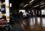 A fighter hits the heavy bag at the Newburgh Boxing Club in Newburgh, NY.