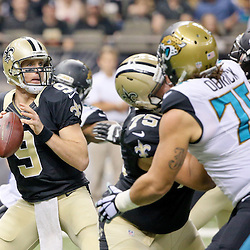 Dec 27, 2015; New Orleans, LA, USA; New Orleans Saints quarterback Drew Brees (9) against the Jacksonville Jaguars during the first quarter of a game at the Mercedes-Benz Superdome. Mandatory Credit: Derick E. Hingle-USA TODAY Sports