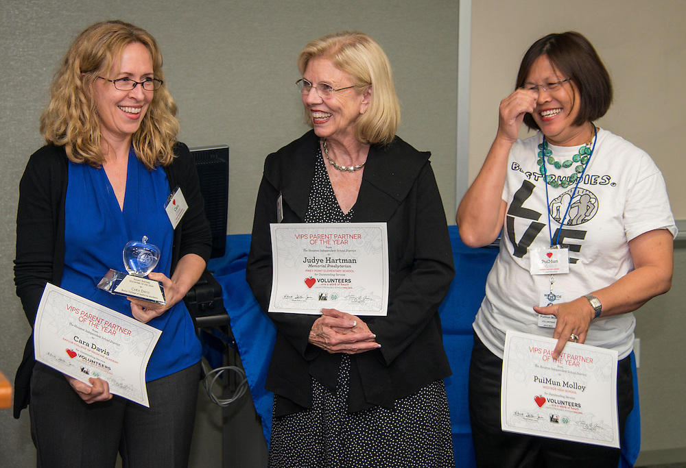 Cara Davis, left, is named the Parent Partner of the Year during Volunteers in Public Schools recognition ceremony, May 14, 2015.