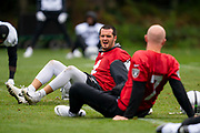 Derek Carr (QB) of the Oakland Raiders jokes Mike Glennon (QB) of the Oakland Raiders during the practice session for Oakland Raiders at the Grove Hotel, Chandlers Cross, United Kingdom on 4 October 2019.
