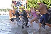 Competitors start the swimming leg of the inaugural Little Traverse Triathalon in Harbor Springs, Michigan.