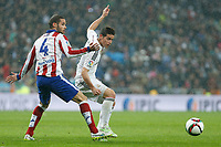 Real Madrid´s James Rodriguez (R) and Atletico de Madrid´s Mario Suarez during Spanish King´s Cup match at Santiago Bernabeu stadium in Madrid, Spain. January 15, 2015. (ALTERPHOTOS/Victor Blanco)