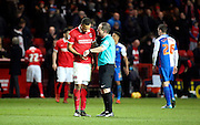 Charlton Athletic midfielder, Jordan Cousins (8) looking at refs watch after 6 minutes of injury time during the Sky Bet Championship match between Charlton Athletic and Blackburn Rovers at The Valley, London, England on 23 January 2016. Photo by Matthew Redman.
