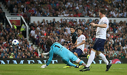 England's Jeremy Lynch (centre) scores his side's second goal of the game during the UNICEF Soccer Aid match at Old Trafford, Manchester.