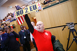 © Licensed to London News Pictures. 13/01/2018. London, UK. A group of protesters shouting pro-Brexit and Pro-Donald Trump slogans, heckle Mayor of London Sadiq Khan while he speaks at the Fabian Society New Year conference in London. Police were called to deal with the incident at the annual gathering of the British socialist movement.  Photo credit: Tom Nicholson/LNP