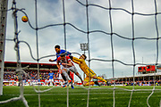 Hamilton Keeper Gary Woods punches clear as Connor Goldson & Aaron McGowan challenge for the ball on the edge of the 6 yard box during the Ladbrokes Scottish Premiership match between Hamilton Academical FC and Rangers at The Hope CBD Stadium, Hamilton, Scotland on 24 February 2019.