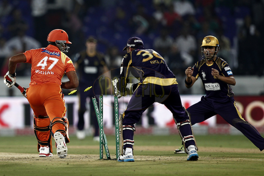 Manvinder Bisla of the Kolkata Knight Riders trying to stamping of Wahab Riaz of the LAHORE LIONS during match 7 of the Oppo Champions League Twenty20 between the Kolkata Knight Riders and the Lahore Lions held at the Rajiv Gandhi Cricket Stadium, Hyderabad, India on the 21st September 2014<br /> <br /> Photo by:  Deepak Malik / Sportzpics/ CLT20<br /> <br /> <br /> Image use is subject to the terms and conditions as laid out by the BCCI/ CLT20.  The terms and conditions can be downloaded here:<br /> <br /> http://sportzpics.photoshelter.com/gallery/CLT20-Image-Terms-and-Conditions-2014/G0000IfNJn535VPU/C0000QhhKadWcjYs