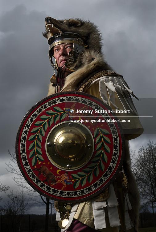 Joe Witcombe, known as Valerius Secundus, a Hamian Syrian archer of The Antonine Guard, the 6th legion who worked on the The Antonine Wall, wearing a wolf skin over his helmet, near Rough Castle Roman fort, Scotland, on Sunday 21st April 2013.