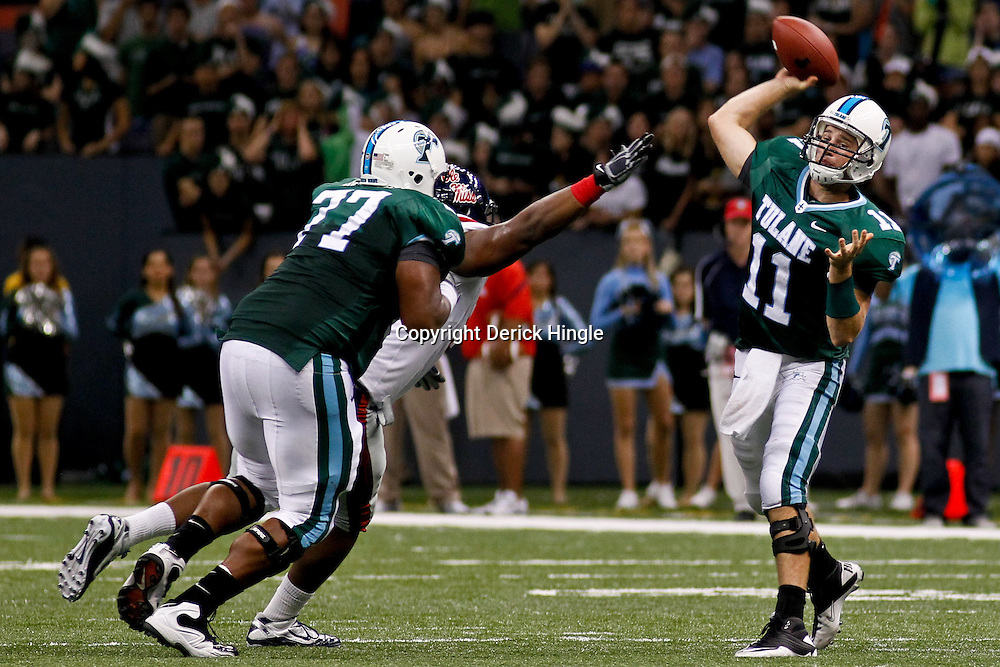 Sep 11, 2010; New Orleans, LA, USA; Tulane Green Wave quarterback Ryan Griffin (11) passes as Mississippi Rebels defensive tackle LaMark Armour (94) pressures during a game at the Louisiana Superdome. The Mississippi Rebels defeated the Tulane Green Wave 27-13.  Mandatory Credit: Derick E. Hingle