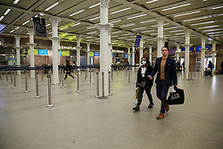 © Licensed to London News Pictures. 13/03/2020. London, UK. A couple at an empty St Pancras International departures amid an increased number of Coronavirus (COVID-19) cases in the UK. 798 cases have been tested positive and ten patients have died from the virus in the UK. Photo credit: Dinendra Haria/LNP