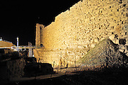 Middle East, Hashemite Kingdom of Jordan, Karak Governorate, the city of Al Karak in centre Jordan. The Karak Crusader Castle built in 1140 Raynald of Chatillon gained possession of Kerak in 1176. Night shot of the outer wall and moat