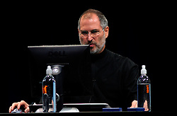 10/16/03, SAN  FRANCISCO, CALIFORNIA, UNITED STATES--A rare site, Apple CEO Steve Jobs uses a Dell Windows computer during the Apple iTunes for Windows launch event at the Moscone Center in San Francisco, California. Photo by  Kim Kulish