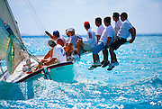 "356204-1173B ~ Copyright:  George H. H. Huey ~  ""Lonesome Dove"" sailing to windward with crew riding the pry. National Family Island Regatta. George Town, Great Exuma Island, Bahamas."