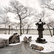Recent snowfall has left a blanket of snow around the Cherry Blossom Lantern on the banks of the Tidal Basin in Washington DC.