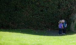 © under license to London News Pictures.  08/04/2011..Friends Lexie Clarke, 2 (left) and Riley Barratt, 3, steal a kiss in a shady spot as they enjoy the sunshine and play in the grounds of Salisbury Cathedral in Wiltshire...Photo credit should read Ian Forsyth/LNP