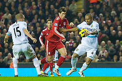 LIVERPOOL, ENGLAND - Saturday, November 20, 2010: Liverpool's Fernando Torres is denied a clear goalscoring opportunity by the hand of West Ham United's Daniel Gabbidon but wins his side a penalty kick, during the Premiership match at Anfield. (Photo by: David Rawcliffe/Propaganda)