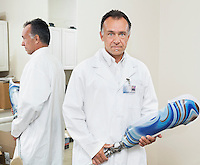 Portrait of a mature technician with advanced prosthetic foot