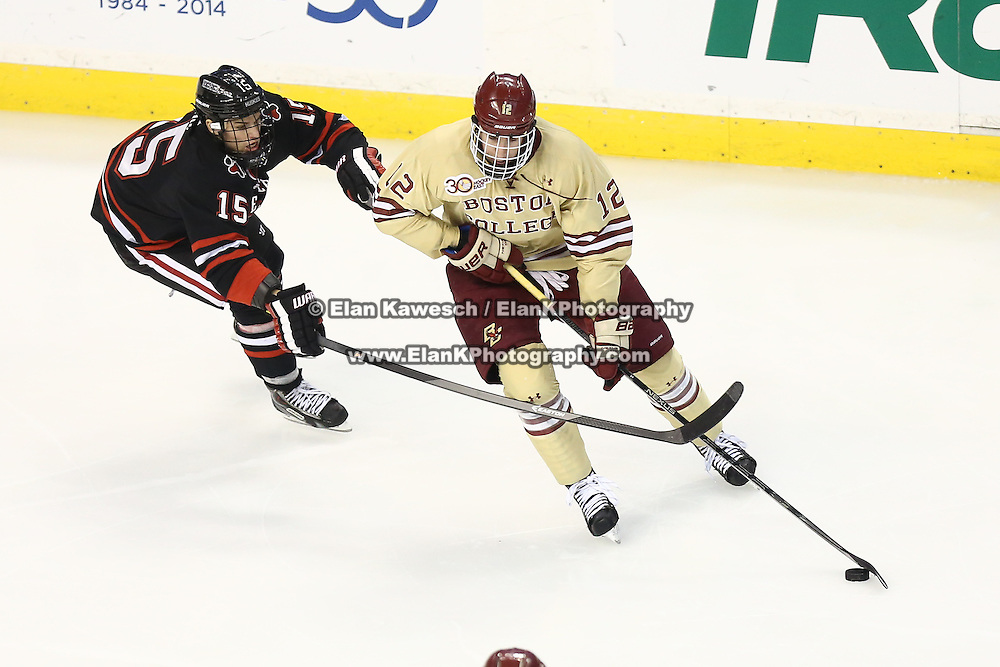 Kevin Hayes #12 of the Boston College Eagles keeps the puck away from Kevin Roy #15 of the Northeastern Huskies during The Beanpot Championship Game at TD Garden on February 10, 2014 in Boston, Massachusetts. (Photo by Elan Kawesch)