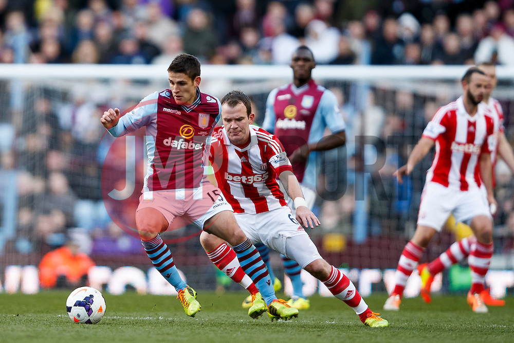 Aston Villa Midfielder Ashley Westwood (ENG) is challenged by Stoke Midfielder Glenn Whelan (IRL) - Photo mandatory by-line: Rogan Thomson/JMP - 07966 386802 - 23/03/2014 - SPORT - FOOTBALL - Villa Park, Birmingham - Aston Villa v Stoke City - Barclays Premier League.