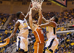 Feb 20, 2017; Morgantown, WV, USA; West Virginia Mountaineers forward Lamont West (15) blocks Texas Longhorns guard Eric Davis Jr. (10) during the first half at WVU Coliseum. Mandatory Credit: Ben Queen-USA TODAY Sports