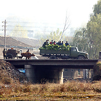 MANPO , OCTOBER-26:  locals ride on a truck along the coast in Manpo, North Korea,October 26,2006.  The military site of the nuclear test conducted by North Korea on october 9,2006 is located at a distance of 50 km from Manpo.