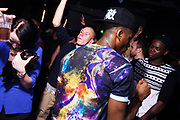 Man in R&B nightclub wears strong patterns and colours. Brighton 2014