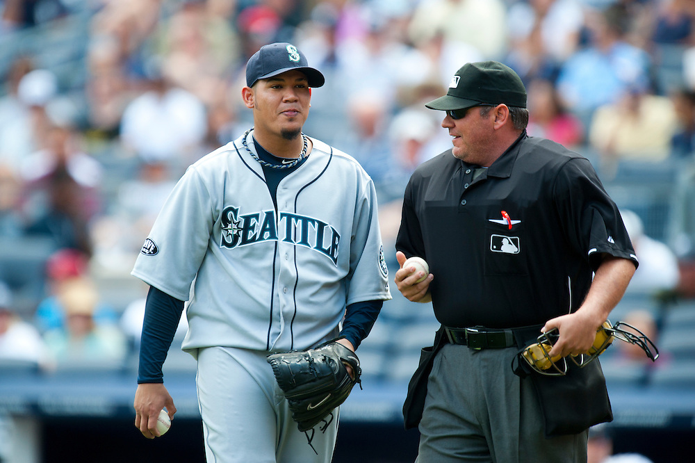 NEW YORK - JULY 27: Felix Hernandez #34 of the Seattle Mariners talks with the home plate during the game against the New York Yankees at Yankee Stadium on July 27, 2011 in the Bronx borough of Manhattan. (Photo by Rob Tringali) *** Local Caption *** Felix Hernandez