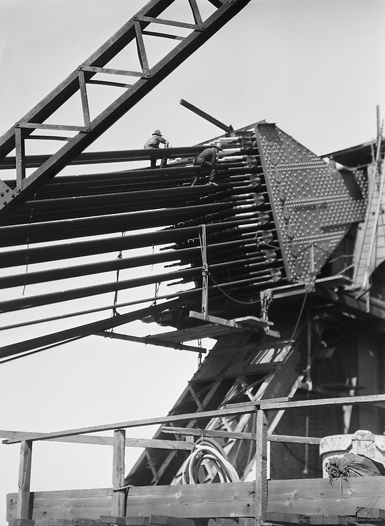 Fixing greasecaps on the cableheads of the Sydney Harbour Bridge, Australia, 1930