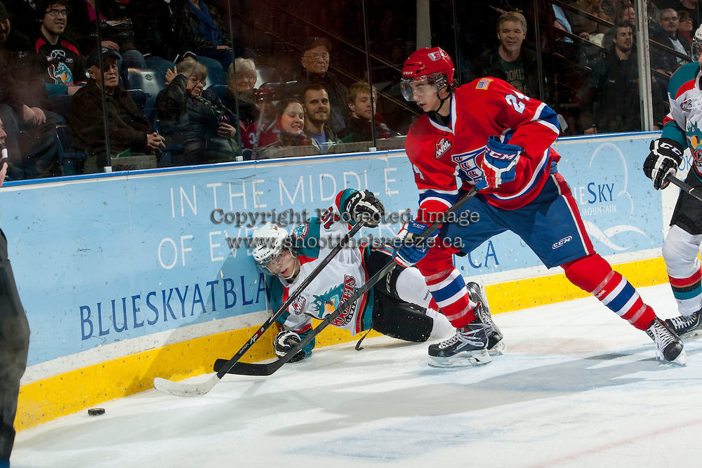 KELOWNA, CANADA - MARCH 5: Cole Wedman #24 of the Spokane Chiefs checks Nick Merkley #10 of the Kelowna Rockets into the boards during third period on March 5, 2014 at Prospera Place in Kelowna, British Columbia, Canada.   (Photo by Marissa Baecker/Getty Images)  *** Local Caption *** Cole Wedman; Nick Merkley;