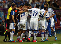 Football - European Championships 2012 - Greece v Russia<br /> <br /> Giorgos Karagounis is congratulated by team mates after opening the scoring for Greece at the National Stadium, Warsaw