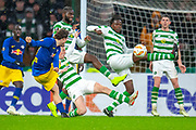 Dedryck Boyata (#20) of Celtic FC and Callum McGregor (#42) of Celtic FC block a shot from Marcel Sabitzer (#7) of RB Leipzig during the Europa League group stage match between Celtic and RP Leipzig at Celtic Park, Glasgow, Scotland on 8 November 2018.